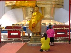 At the Giant Buddhas feet
